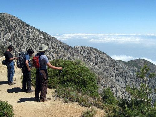 photo-of-hiking-on-the-ridge-of-a-mountain